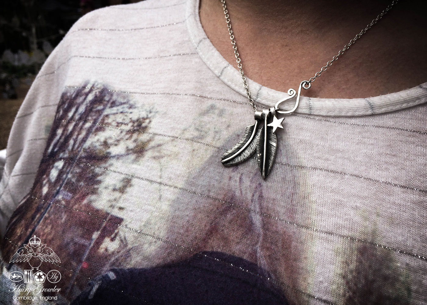 Feather jewellery handcrafted recycled silver coins
