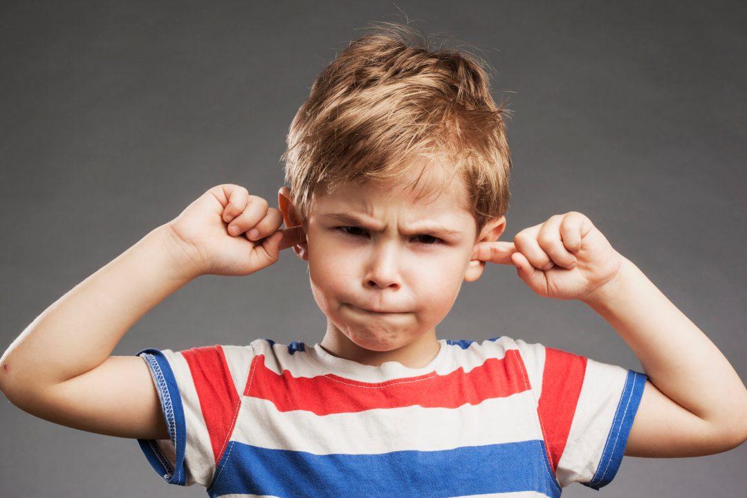 angry boy fingers in ears