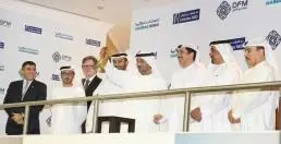 Sheikh-Ahmed-Saeed-rings-bell-to-celebrate-listing-of-a-500-million-dollar-Emirates-NBD-bond-on-NASDAQ-Dubai