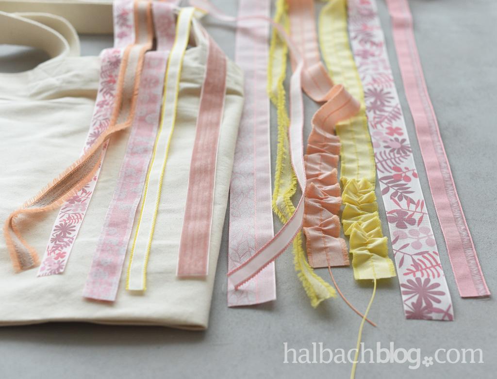 DIY-Idee Halbachblog: Bänder in Rosa-, Apricot- und Gelbtönen auf Tasche nähen