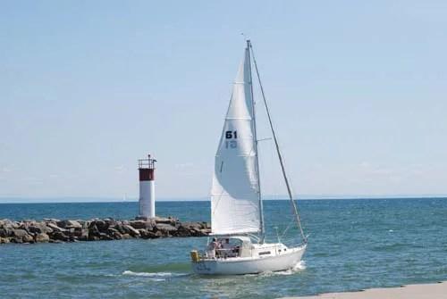 A sailing boat lazily sailing on a lake