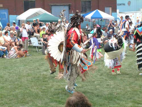 A First Nations member performing a ceremonial dance during a pow wow