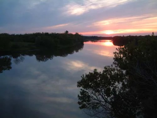The comforting hues of dusk are reflected into the mirror-like finish of the Grand River providing an endless sky to anyone fortunate enough to witness