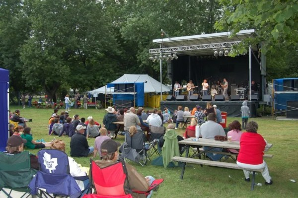 A band plays on stage in front of a delighted audience during Cayuga's celebration of Canada's 150th anniversary