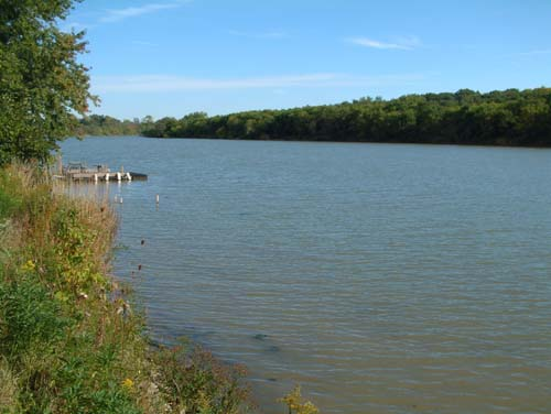 An old dock extends into the gentle ripples of the great Grand River