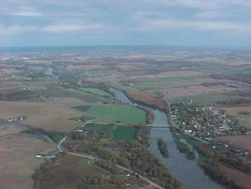 An aerial view of the Grand River along with the surrounding fields and farms