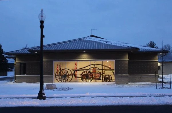 Cayuga Fire Station #4 with an image of the old pump