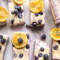Blueberry Lemon Cheesecake Bars with Candied Lemon.