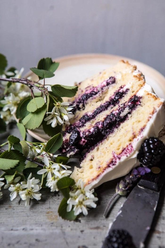 close up photo of Blackberry Lavender Naked Cake slice