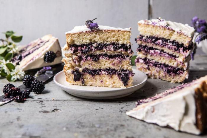 horizontal photo of Blackberry Lavender Naked Cake with White Chocolate Buttercream