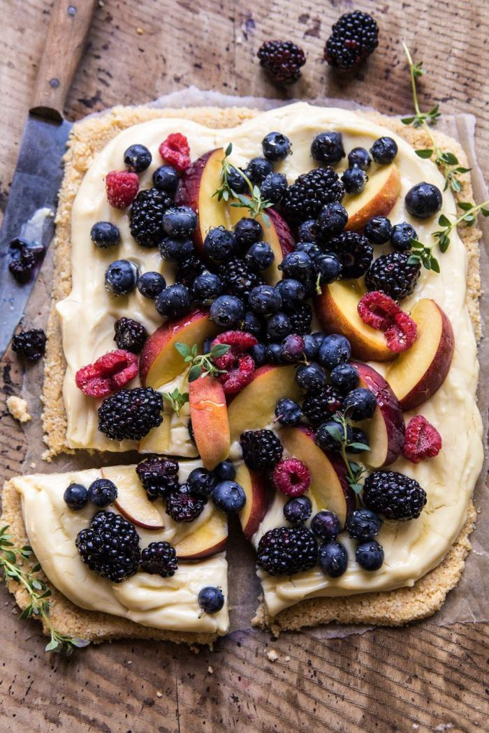 overhead photo of No Bake Mixed Berry Custard Tart with piece cut out an knife in photo