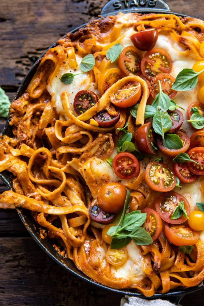 overhead close up photo of One Pot 30 Minute Creamy Tomato Basil Pasta Bake with serving of pasta removed