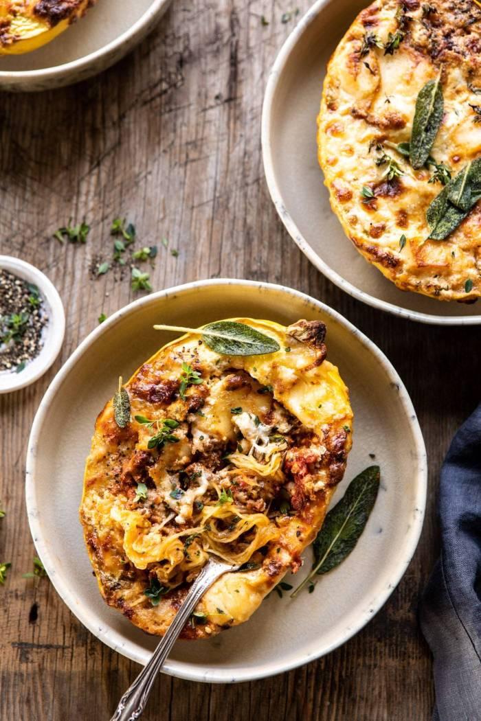 overhead photo of Roasted Garlic Spaghetti Squash Lasagna Boats with fork in spaghetti squash