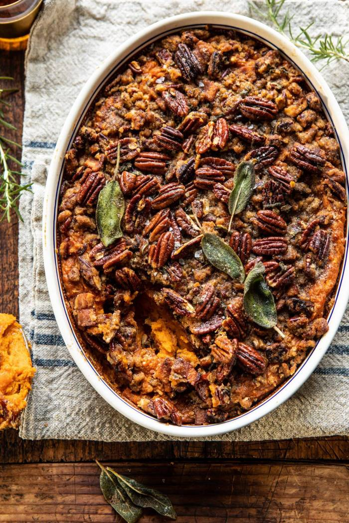 overhead photo of Bourbon Sweet Potato Casserole with Sweet n Savory Bacon Pecans with spoonful removed from casserole