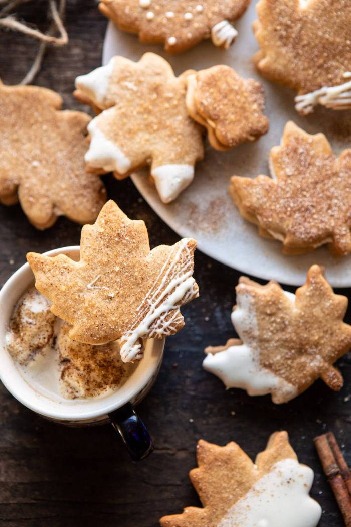 overhead photo of Chai Spiced Maple Sugar Cookie with Browned Butter Frosting resting on top of a mug of chai tea