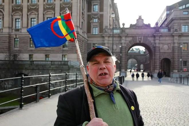 Sami Man Protesting Stockholm Flag