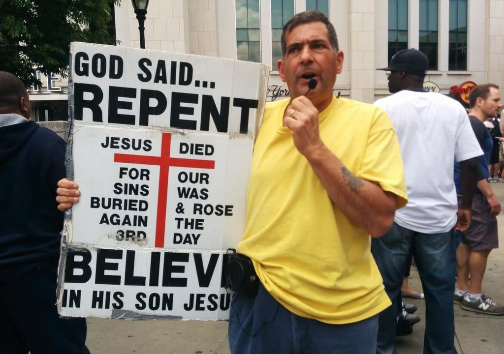 Yankee Repent Man Sign
