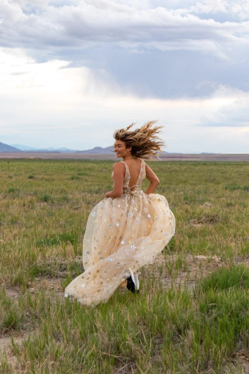 bride running through a utah field