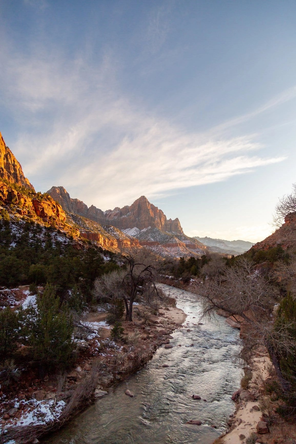the Virgin River flowing through the canyon walls of Zion to the iconic Watchmen Tower