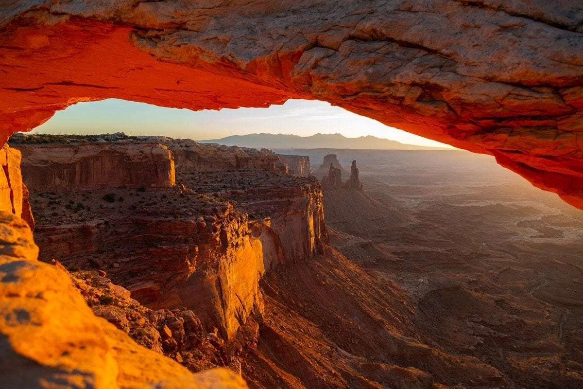 mesa arch in canyonlands national park at sunrise. This destination is great for having your wedding photos taken at