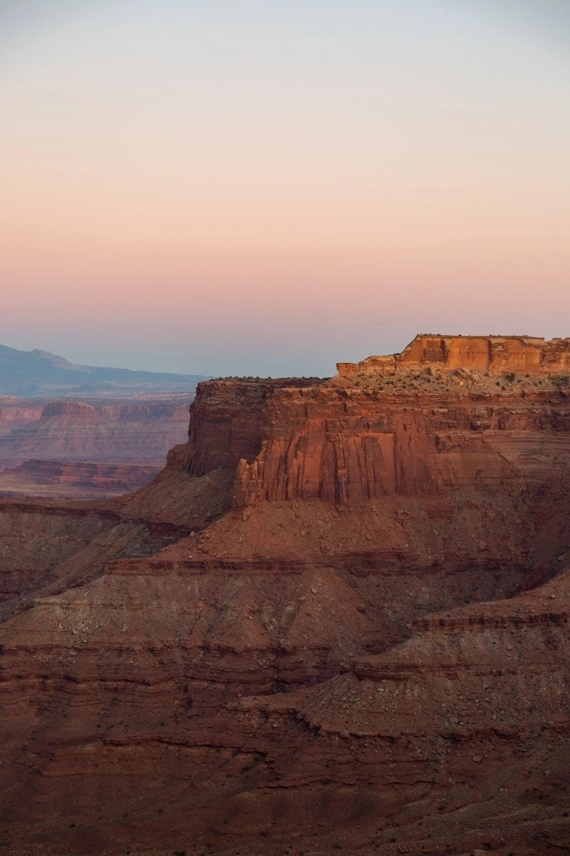 white rim overlook at sunset in canyonlands southern utah