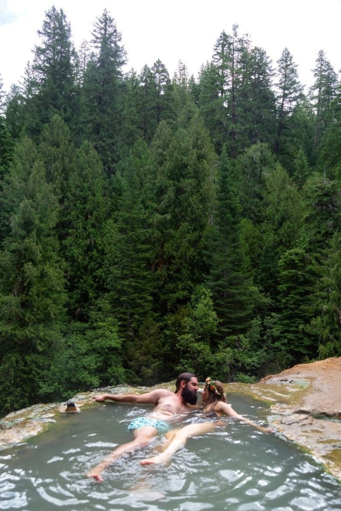 eloping couple at a hot spring after their sunrise first look in Oregon
