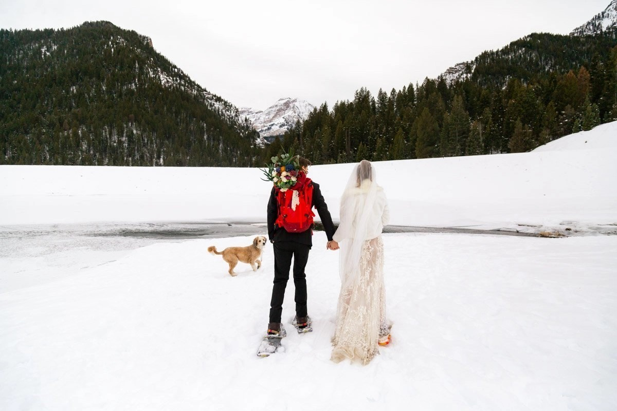 snowshoeing in the moutains for a winter wedding day with a pup