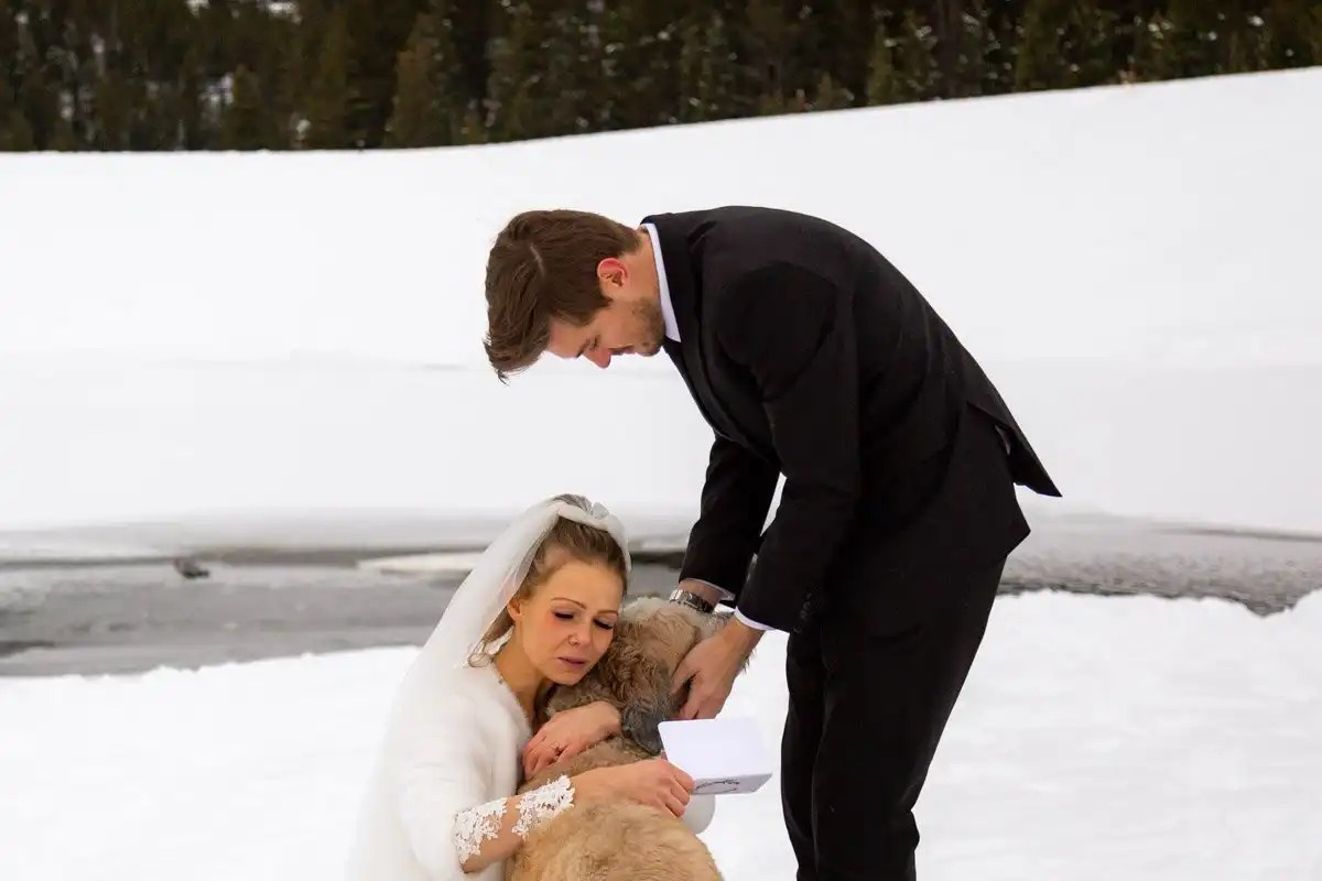 couple loves on their dog during their vow reading