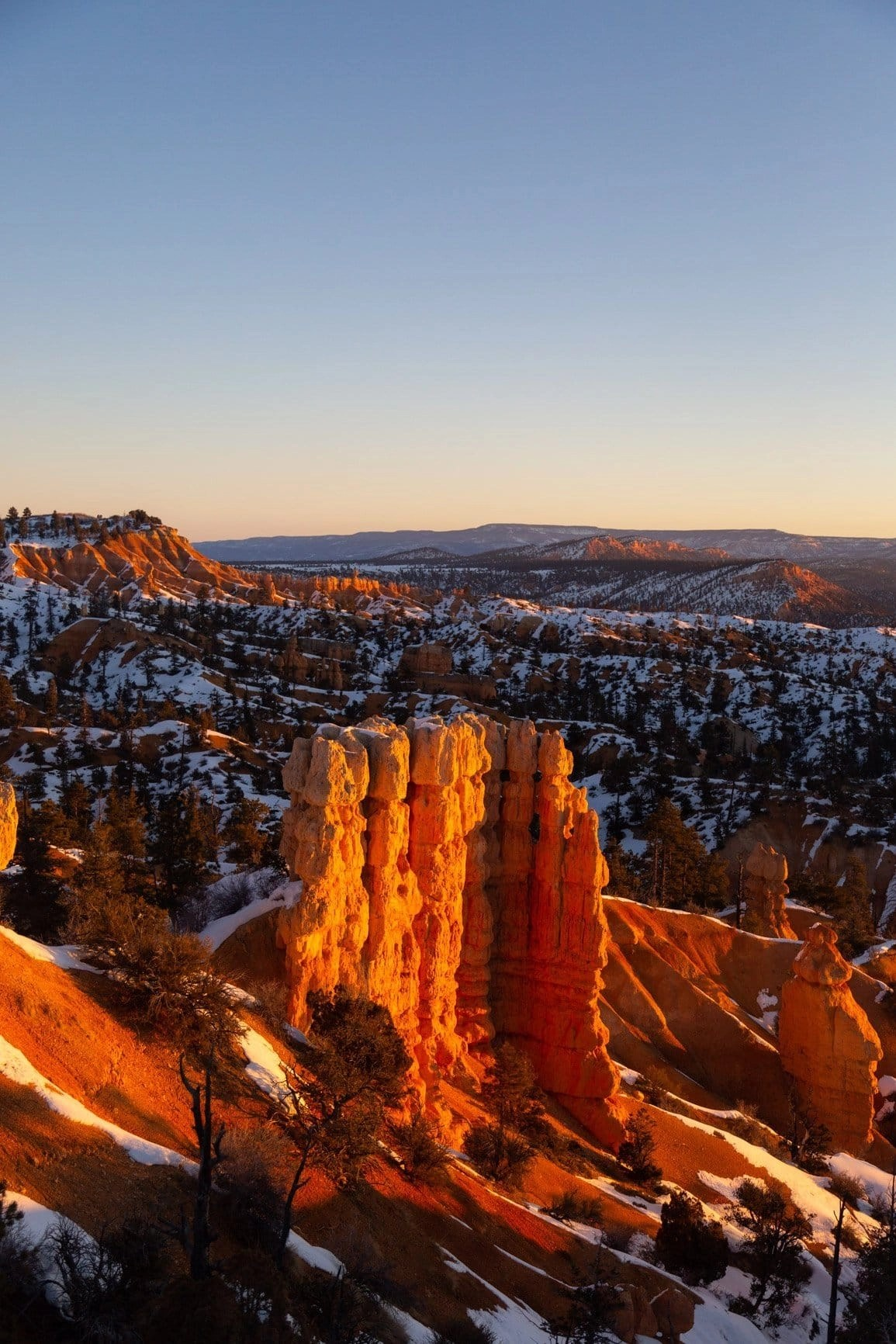 the hoodoos of bryce canyon national park at sunrise are absolutely incredible. you won't beat the views on your adventure to bryce as you explore more of southern utah and all of its beauty