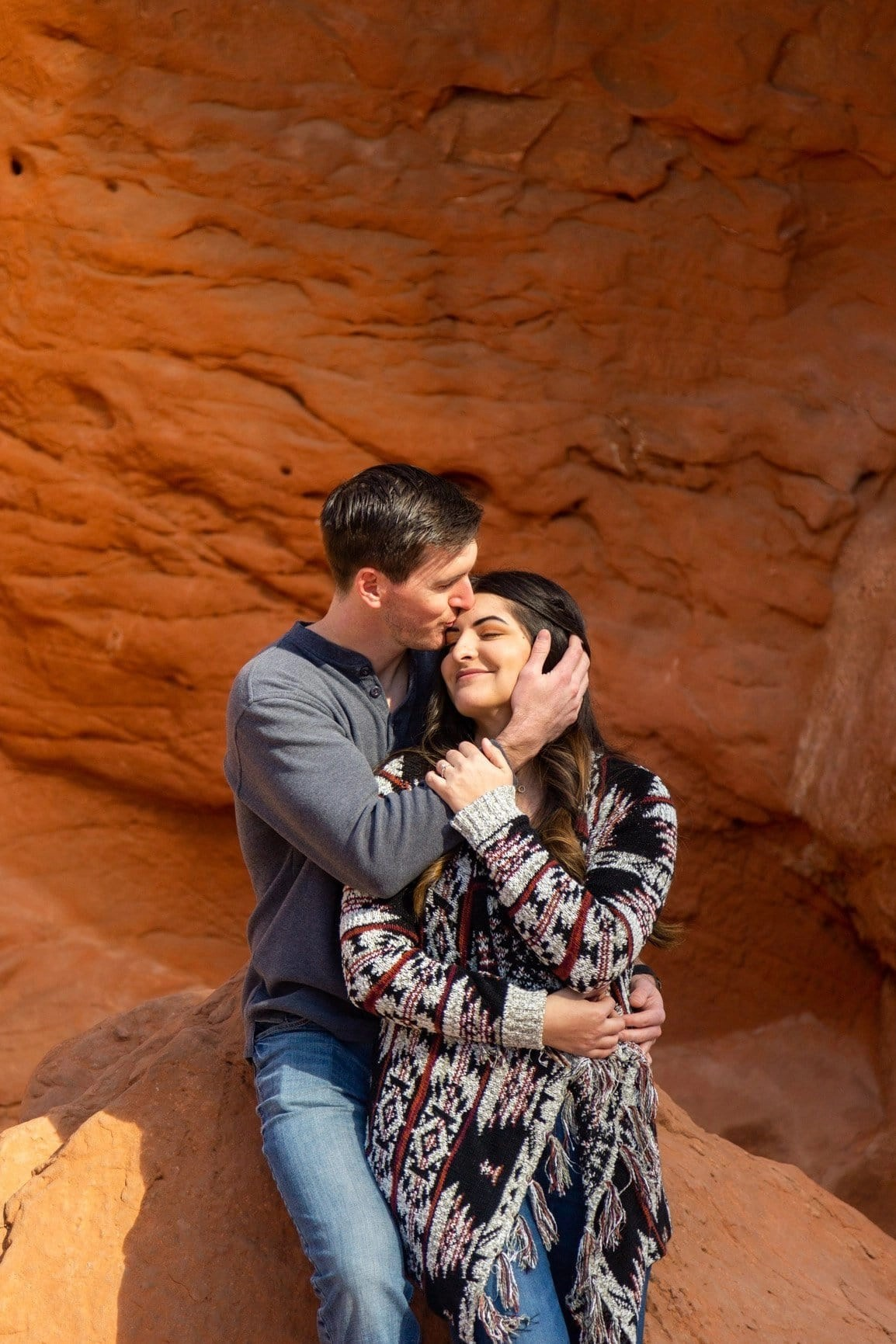Forehead kisses among the sandstone towers in Garden of the Gods. Engagement sessions are great when you can get out among beautiful places and be captured in your element
