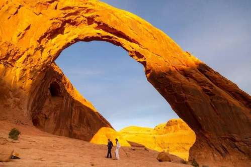 halie west photography elopement photographer in moab utah at the corona arch