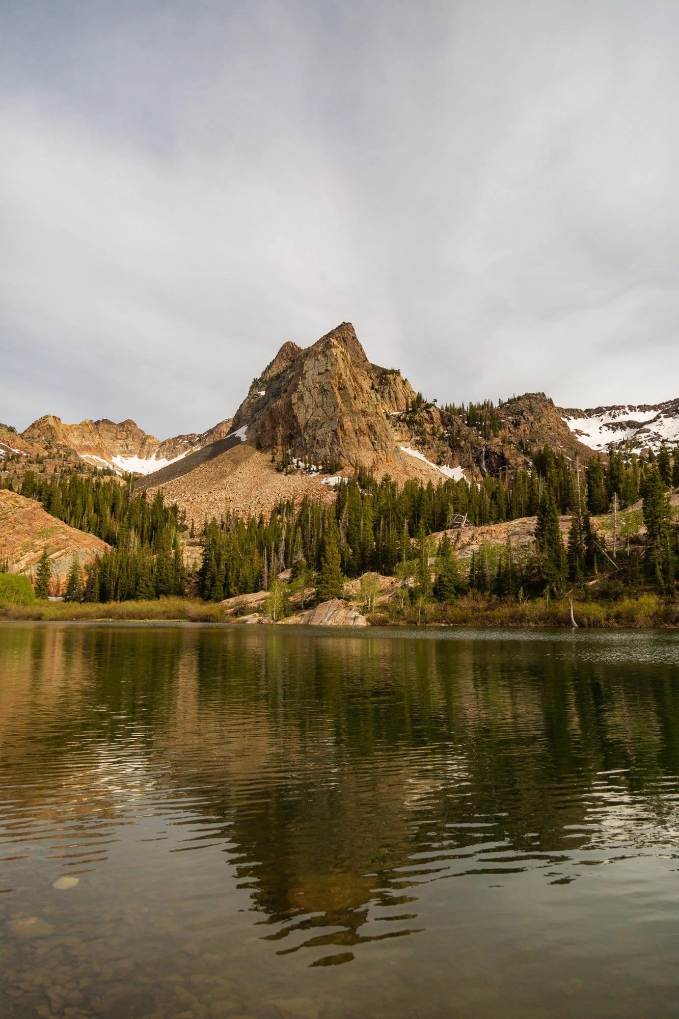 the reflection of lake blanche in blanche lake in the wasatch mountains