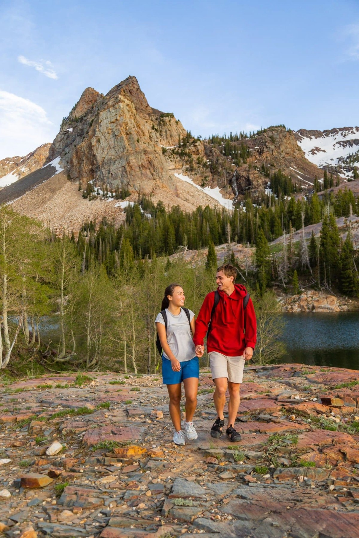 a couple hiking in the wasatch mountains at lake blanche