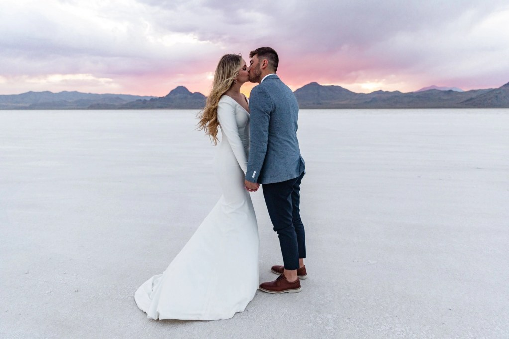 an eloping couple kissinf at the bonneville salt flats in Utah