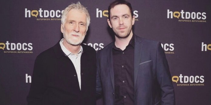 Robbie Delano (right) with Assholes: A Theory director John Walker (left) at Hot Docs.