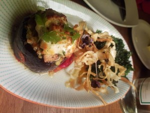 Aubergine bake topped with parmesan and vegetable crisps