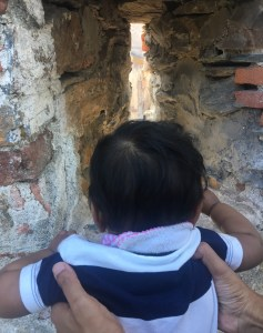baby peeping through the wall