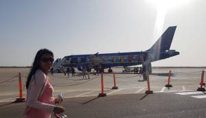 HalimaBobs pregnancy bump boarding plane