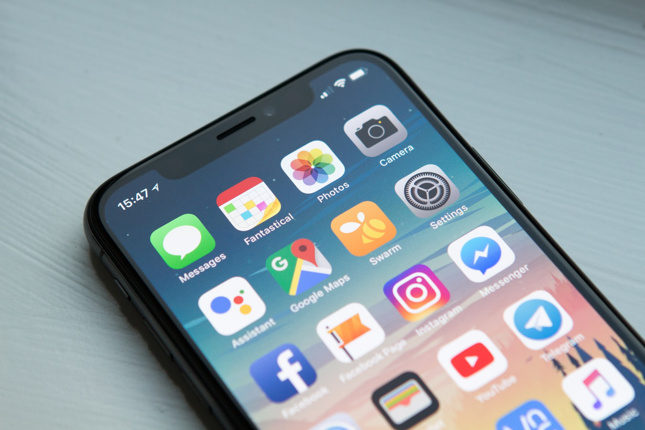 iphone X with apps on screen
