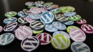 colorful WordPress logo buttons spread out on a table.