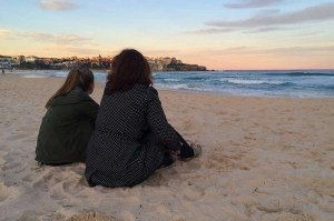 Martina and Janine reflecting on the past year as they watch the sun go down at Bondi Beach
