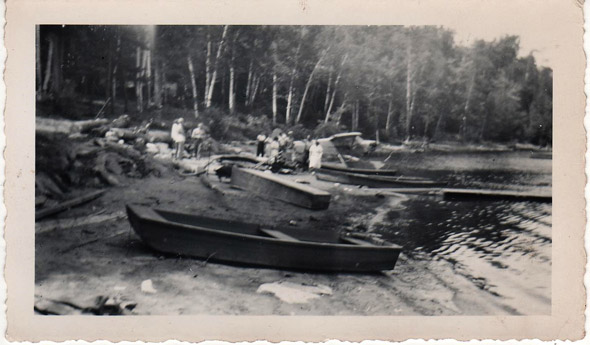 Boats and people on the shore