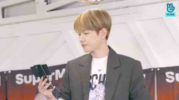 Baekhyun of EXO and SuperM holding a LG WING phone