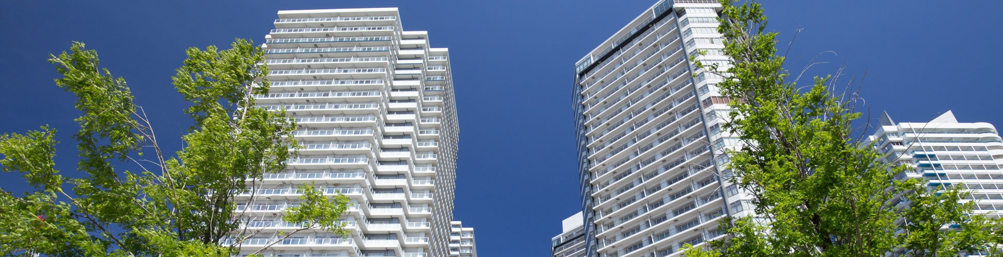 High-Rise Apartments and Street Trees of Green - Commercial Real Estate law
