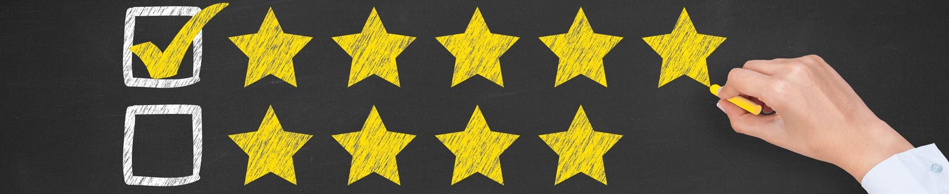 Rating Five Golden Stars on Chalkboard