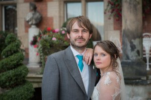 bride and groom in front of Capesthorne Hall in Cheshire