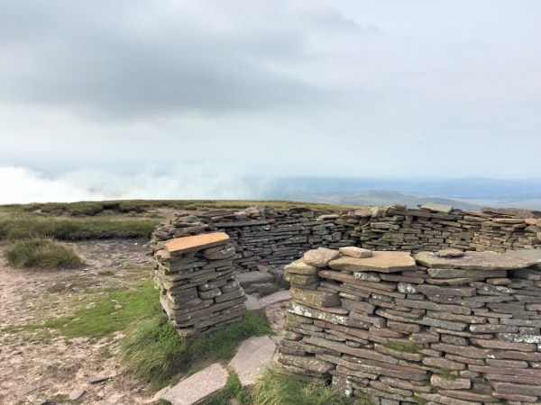 This is the lovely well built cairn on the summit