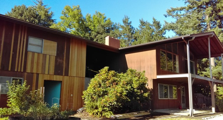 1960s house prepped for exterior stain