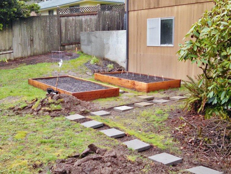 Installing a paver stone path around raised beds