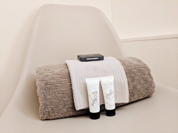 Setting out toiletries in guest room